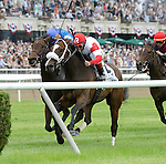 Stephanie's Kitten (no. 2), ridden by John Velazquez and trained by Wayne Catalano, wins the 20th running of the grade 1 Just a Game Stakes for fillies and mares three years old and upward on June 8, 2013 at Belmont Park in Elmont, New York.  (Bob Mayberger/Eclipse Sportswire)