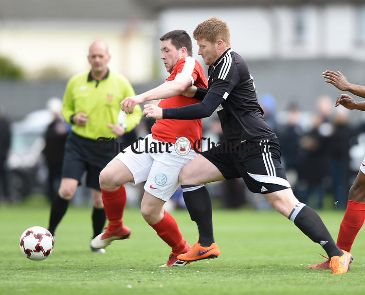 Cathal Hayes of Newmarket Celtic in action against Thomas Clarke of Janesboro during their Munster Junior Cup semi-final at Limerick. Photograph by John Kelly.