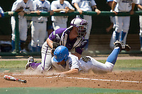 TCU catcher Bryan Holaday tags out a UCLA baserunnerin Game 13 of the NCAA Division One Men's College World Series on June 26th, 2010 at Johnny Rosenblatt Stadium in Omaha, Nebraska.  (Photo by Andrew Woolley / Four Seam Images)