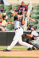 Kevan Smith #32 of the Kannapolis Intimidators blasts an RBI double off the right field wall against the Rome Braves at CMC-Northeast Stadium on May 28, 2012 in Kannapolis, North Carolina.  The Intimidators defeated the Braves 6-4.  (Brian Westerholt/Four Seam Images)