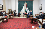 Palestinian President Mahmoud Abbas, meets with the Minister of Health, Dr. Mai Keela, in the West Bank city of Ramallah, on November 10, 2020. Photo by Thaer Ganaim