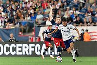 FOXBOROUGH, MA - AUGUST 18: Yamil Asad #11 of D.C. United dribbles as Tommy McNamara #26 of New England Revolution defends during a game between D.C. United and New England Revolution at Gillette Stadium on August 18, 2021 in Foxborough, Massachusetts.