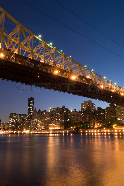 AVAILABLE FROM PLAINPICTURE FOR COMMMERCIAL AND EDITORIAL LICENSING.  Please go to www.plainpicture.com and search for image #p5690171.<br /> <br /> Queensboro Bridge (also known as the 59th Street Bridge), Midtown Manhattan and the East River at Dusk, New York City, New York State, USA