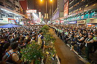 Pro-democracy protesters face off against the Hong Kong police force, shortly before the police lost control of the area, and thus ceded it back to the protesters, who had only just lost it to the police hours earlier in a pre-dawn raid, Mong Kok, Kowloon, Hong Kong, China, 18 October 2014.