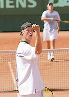 Martin Verkerk juicht terwijl zijn zojuist verslagen tegenstander Carcia naar het net loopt