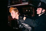 Policeman arrests a Punk Rocker London England 1980s