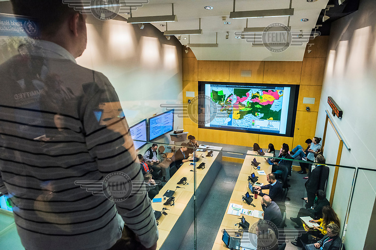 The daily, morning Acute Events Management meeting in the SHOC room (Strategic Health Operations Centre), at the World Health Organization (WHO) headquarters. The WHO, monitors global public health events around the clock, and facilitates international collaboration during public health emergencies and daily operations. Current emergency situations, including coronavrius and ebola, were discussed.