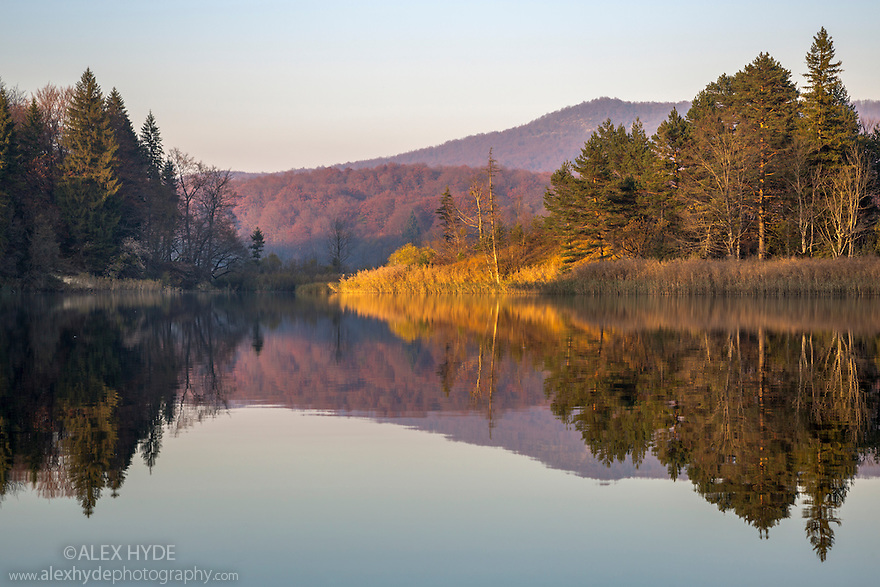 Mirror reflections at sunset in the 'Upper Lakes' region of Plitvice Lakes National Park, Croatia. November.