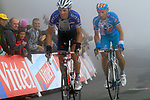Sylvain Chavanel (FRA) Quick Step and Pierrick Fedrigo (FRA) Bbox Bouygues Telecom approach the summit finish of the Col du Tourmalet during a wet foggy Stage 17 of the 2010 Tour de France running 174km from Pau to Col du Tourmalet, France. 22nd July 2010.<br /> (Photo by Eoin Clarke/NEWSFILE).<br /> All photos usage must carry mandatory copyright credit (© NEWSFILE | Eoin Clarke)
