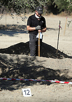 FAO JANET TOMLINSON, DAILY MAIL PICTURE DESK<br /> Pictured: A special forensics police officer holds an evidence bag during the search of a field in Kos, Greece. Sunday 02 October 2016<br /> Re: Police teams led by South Yorkshire Police, searching for missing toddler Ben Needham on the Greek island of Kos have moved to a new area in the field they are searching.<br /> Ben, from Sheffield, was 21 months old when he disappeared on 24 July 1991 during a family holiday.<br /> Digging has begun at a new site after a fresh line of inquiry suggested he could have been crushed by a digger.