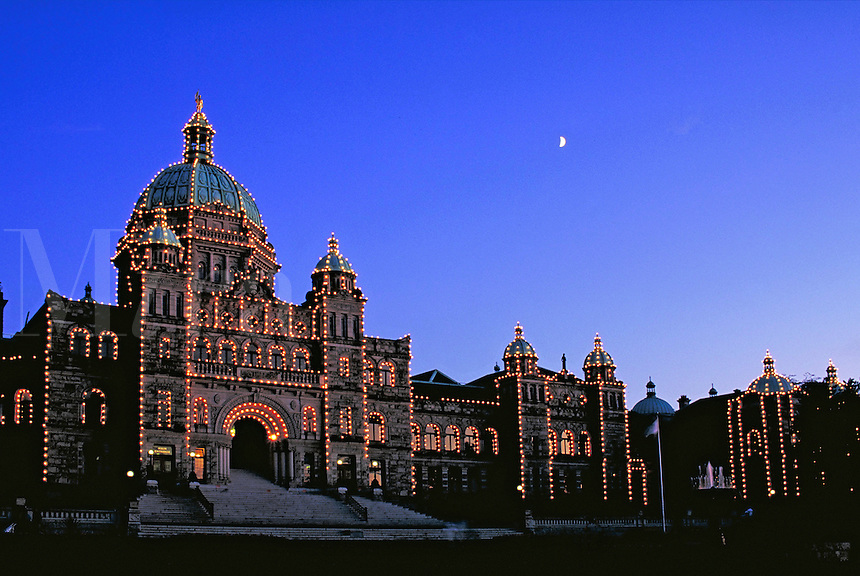 BC parliament buildings, the seat of provincial government, lit up at night .tourism, tourist attraction, landmark, night, lights, illumination. Victoria British Columbia Canada City Center.