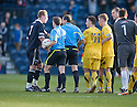 THE OFFICIALS STEP IN AS THINGS GET HEATED AFTER THE FINAL WHISTLE