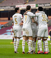 9th January 2021; Turf Moor, Burnley, Lanchashire, England; English FA Cup Football, Burnley versus Milton Keynes Dons; MK DONs team celebrate taking the lead in min 29 after Cameron Jerome of MK Dons scores header