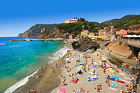 Pictures of tourists sunbathing on the beach of Monterosso al Mare, Cinque Terre National Park, Liguria, Italy