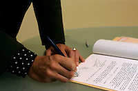 Hands of a businesswoman signing a contract.