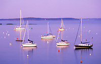 USA, Maine, Camden, Camden Harbour, Penobscot Bay, sailboats moored in the bay at twilight