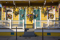 French Quarter, New Orleans, Louisiana.  Double Shotgun House with Porch and Flower Decorations.