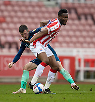 20th March 2021; Bet365 Stadium, Stoke, Staffordshire, England; English Football League Championship Football, Stoke City versus Derby County; John Obi Mikel of Stoke City is tackled by Jason Knight of Derby County