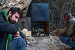 Balkan Lynx (Lynx lynx balcanicus) biologist, Alexander Pavlov, former hunter turned conservationist, Plumb Mustafa, and biologist, Dime Melovski, maintaining box trap, Mavrovo National Park, North Macedonia