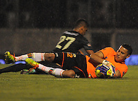 MEDELLIN -COLOMBIA-26-04-2014: Victor Soto guardameta  (Der.) del Envigado F.C. disputa el balon con Santiago Trellez  (Izq.) jugador del Atletico Nacional durante partido de los cuartos de final  de la Liga Postobon I 2014, jugado en el estadio Polideportivo Sur  de Medellin. /  Victor Soto goalkeeper (R) of Envigado F. C. dispute the ball with Santiago Trellez  (L) during Atletico Nacional player match of the quarter-finals of the League I Postobon 2014, played at the Polideportivo Sur of Medellin.. Photo: VizzorImage  / Luis Rios  / Str.