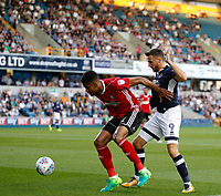 Millwall's Lee Gregory tussles with Ipswich Town's Dominic Iorfa for the ball during the Sky Bet Championship match between Millwall and Ipswich Town at The Den, London, England on 15 August 2017. Photo by Carlton Myrie.