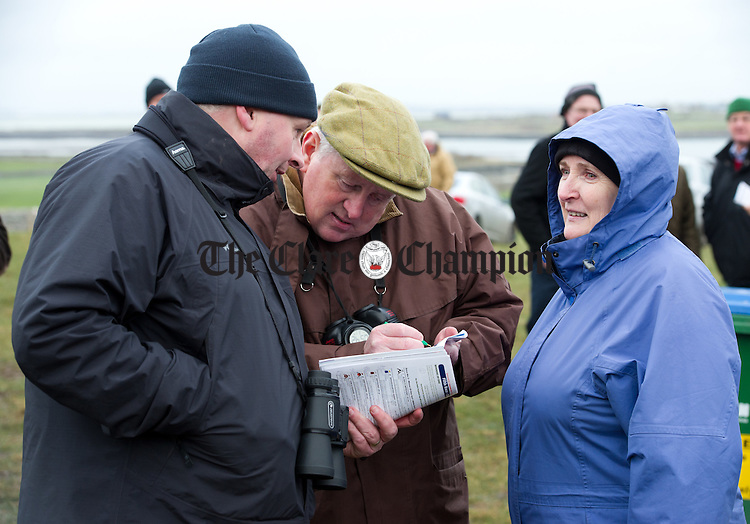 Tom Cotter, Mike Barrett and Anne O Connor of Cork discussing form at the County Clare Hunt Point To Point in Bellharbour. Photograph by John Kelly.