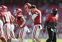 Arkansas quarterback Feleipe Franks (13) puts his helmet on, Saturday, October 17, 2020 during the first quarter of a football game at Donald W. Reynolds Razorback Stadium in Fayetteville. Check out nwaonline.com/201018Daily/ for today's photo gallery. <br /> (NWA Democrat-Gazette/Charlie Kaijo)
