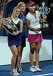 Na Li (CHN) (pink cap) wins the women's title at the Australian Open in Melbourne Australia by beating Dominka Cibulkova (SVK) 7-6, 6-0 on January 25, 2015.