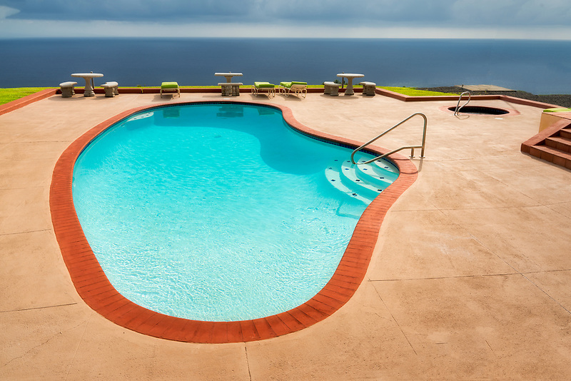 Swimming pool on ocean at Makai Hale in Hawaii the big island. B&B