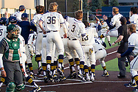 Michigan Wolverines designated hitter Jimmy Obertop (8) is greeted at the plate after his ninth inning game winning walk-off 2 run home run against the Michigan State Spartans on March 21, 2021 in NCAA baseball action at Ray Fisher Stadium in Ann Arbor, Michigan. Michigan scored 8 runs in the bottom of the ninth inning to defeat the Spartans 8-7. (Andrew Woolley/Four Seam Images)