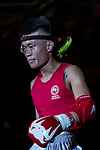 Liu Hin Chung (Red) of Hong Kong enters to the ring prior the male muay 54KG division weight bout against Xiao Feng (Not in picture) of China during the East Asian Muaythai Championships 2017 at the Queen Elizabeth Stadium on 13 August 2017, in Hong Kong, China. Photo by Yu Chun Christopher Wong / Power Sport Images