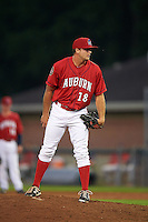 Auburn Doubledays pitcher Adam Boghosian (18) looks in for the sign during a game against the State College Spikes on July 6, 2015 at Falcon Park in Auburn, New York.  State College defeated Auburn 9-7.  (Mike Janes/Four Seam Images)