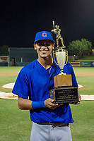 Luis Vazquez (1) of the AZL Giants poses with the Chuck Jared Championship Cup after winning Game Three of the Arizona League Championship Series against the AZL Giants on September 7, 2017 at Scottsdale Stadium in Scottsdale, Arizona. AZL Cubs defeated the AZL Giants 13-3 to win the series two games to one. (Zachary Lucy/Four Seam Images)