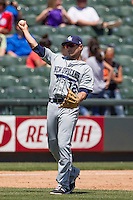 New Orleans Zephyrs third baseman Josh Rodriguez #12 makes a throw to first base during the Pacific Coast League baseball game against the Round Rock Express on May 5, 2014 at the Dell Diamond in Round Rock, Texas. The Zephyrs defeated the Express 13-4. (Andrew Woolley/Four Seam Images)
