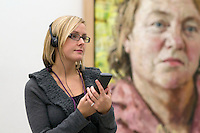 National Portrait Gallery, London.  Using the Audioguide infront of a painting of Mo Mowlam by John Keane.