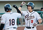 Reno Aces Mike Jacobs gets five from Josh Bell after hitting a two run homerun in the first inning agianst the Albuquerque Isotopes during their game on Friday night August 10, 2012 at Aces Ballpark in Reno NV.