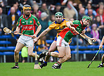 Brian Carey of Sixmilebridge in action against Bryan Mc Inerney of  Clooney-Quin during their senior county final at Cusack Park. Photograph by John Kelly.