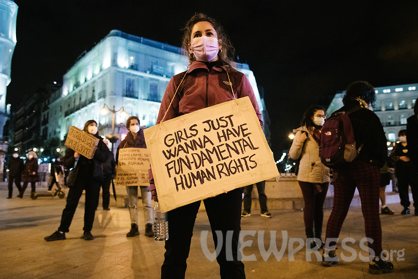MADRID, SPAIN – MARCH 08: A group of protesters demonstrating on women's day in front of the Puerta del Sol on 8 march in Madrid, Spain. Despite the prohibition by the government delegation alleging health and protection reasons against COVID-19, various demonstrations and protests have been carried out to celebrate he international day of working women (Photo by Joan Amengual / VIEWpress via Getty Images)