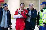 St Johnstone v Ross County.....21.04.13      SPL.Branislav Micic levaes the pitch after injuring his arm.Picture by Graeme Hart..Copyright Perthshire Picture Agency.Tel: 01738 623350  Mobile: 07990 594431