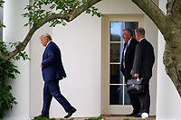 United States President Donald J. Trump, Mark Meadows, Assistant to the President and Chief of Staff, and United States National Security Advisor Robert C. O'Brien, depart the Oval Office before walking to the South Lawn of the White House before boarding Marine One in Washington, D.C., U.S., on Thursday, September 24, 2020.<br /> CAP/MPI/RS<br /> ©RS/MPI/Capital Pictures