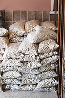 Sacks of cork piled in a corner. Kantina Miqesia or Medaur winery, Koplik. Albania, Balkan, Europe.