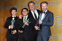 LOS ANGELES, CA - JANUARY 18: Nolan Gould, Rico Rodriguez, Eric Stonestreet, Jesse Tyler Ferguson in the press room at the 20th Annual Screen Actors Guild Awards held at The Shrine Auditorium on January 18, 2014 in Los Angeles, California. (Photo by Xavier Collin/Celebrity Monitor)