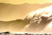 Huge winter surf at Waimea Bay, on the North Shore of Oahu