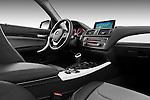 Passenger side dashboard view of a 2011 - 2014 BMW 118d 5 Door hatchback.