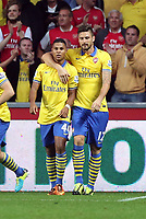 Saturday 28 September 2013<br /> Pictured L-R: Serge Gnabry of Arsenal celebrating his opening goal with team mate Olivier Giroud.<br /> Re: Barclay's Premier League, Swansea City FC v Arsenal at the Liberty Stadium, south Wales.