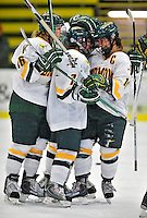 9 October 2009: Members of the University of Vermont Catamounts celebrate a first period goal against the Union Dutchwomen at Gutterson Fieldhouse in Burlington, Vermont. The Catamounts shut out the visiting Dutchwomen 2-0 to start off the Cats' 2009 season. Mandatory Credit: Ed Wolfstein Photo