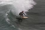 Surfers - Surfing Seal Beach, California.  Photograph by Alan Mahood.