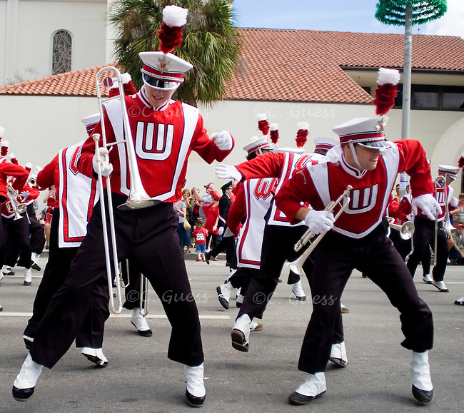 """Two members of the Wisconsin Band break down to """"It's a Family Thing"""" while marching through the streets of Orlando, Fla."""