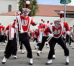 "Two members of the Wisconsin Band break down to ""It's a Family Thing"" while marching through the streets of Orlando, Fla."