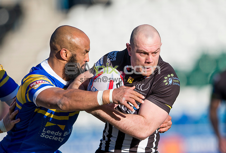 Picture by Allan McKenzie/SWpix.com - 25/02/2018 - Rugby League - Betfred Super League - Widnes Vikings v Leeds Rhinos - Select Security Stadium, Widnes, England - Widnes's Stefan Marsh is tackled by Leeds's Jamie Jones-Buchanan.